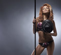 Fashion shoot of a young striptease dancer Royalty Free Stock Photo