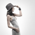 Fashion shoot of a young woman in a grey dress Royalty Free Stock Image