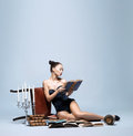 Fashion shoot of a young woman reading books Royalty Free Stock Photos