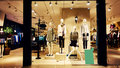 Fashion shop boutique store window display front of women clothes retail with female mannequin Royalty Free Stock Photos