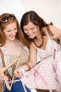 Fashion shopping - Two woman choose sale clothes Stock Photos