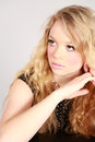Fashion shot of beautiful woman studio blonde girl with curly hair Stock Image