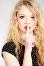 Fashion shot of beautiful woman studio blonde girl with finger to lips Stock Photos