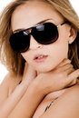 Fashion shot of a beautiful women with sunglasses Royalty Free Stock Photo
