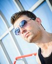 Fashion shot closeup portrait of handsome young m a man wearing sunglasses Royalty Free Stock Photo