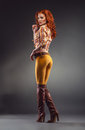 Fashion shot of sexy redhead woman Royalty Free Stock Image