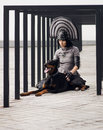 image photo : Fashion shot of a woman with black dog