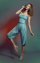 image photo : Fashion shot of a woman in blue costume