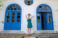 Fashion slim woman standing against old destroyed store wearing green strapless short dress with broken glasses full length body Royalty Free Stock Photography