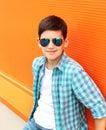 Fashion smiling child boy wearing a sunglasses and shirt Royalty Free Stock Photo