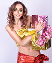 Fashion smiling woman model with presents Stock Images