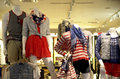 Fashion store nice young men and women s clothing in a mall Stock Images