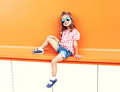 Fashion stylish little girl child wearing sunglasses and checkered shirt in city Royalty Free Stock Photo