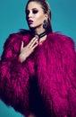 Fashion stylish swag model in fur coat Royalty Free Stock Photo