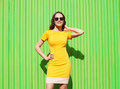 Fashion summer portrait of beautiful young woman in yellow dress Royalty Free Stock Photo