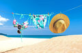 Fashion summer swimsuit bikini, sunglasses and big hat on rope. Summer bikini and accessories stylish outfit beach set. Ocean sea Royalty Free Stock Photo