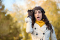 Fashion surprised woman with eyewear in autumn amazed fashionable mouth open looking raising her glasses and fall season concept Royalty Free Stock Images