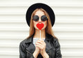 Fashion sweet woman having fun with lollipop over white Royalty Free Stock Photo