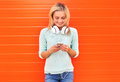 Fashion, technology and people concept - pretty smiling girl Royalty Free Stock Photo