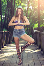 Fashion teen girl with hat and purse urban posing in nature wearing Royalty Free Stock Photos