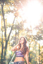 Fashion teen girl with hat and purse urban posing in nature wearing Stock Photography