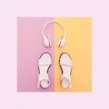 Fashion white sandals and headphones Royalty Free Stock Photo