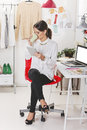 Fashion woman blogger working in a creative workspace with digit coffee break Royalty Free Stock Image