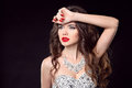 Fashion woman. Elegant lady. Diamond jewelry set. Makeup. Portrait of a brunette girl model with red lips and long wavy hair Royalty Free Stock Photo