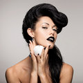 Fashion woman with modern hairstyle with white apple portrait of and lips in black color Stock Image