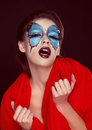 Fashion woman Portrait. Butterfly makeup,  face art make up Royalty Free Stock Image