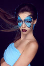 Fashion woman Portrait. Butterfly makeup,  face art make up Stock Image