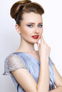 Fashion woman portrait. young model wearing silver evening dress. Hair style back vie Royalty Free Stock Photo