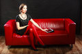 Fashion woman retro style with tablet technology internet business concept sitting on red couch Stock Photo