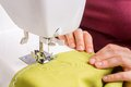 Fashion woman sews with sewing machine Royalty Free Stock Photo