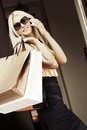 Fashion woman with shopping bags calling on mobile phone Royalty Free Stock Photo