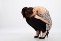 Fashion woman squatting Royalty Free Stock Photos