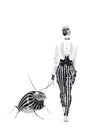 Fashion woman in striped pantaloons walking with bug on white background Royalty Free Stock Photos