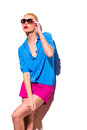 Fashion woman in sunglasses is leaning on the wall. Stock Photography