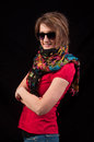Fashion woman with sunglasses and scarf posing on black backgrou over background Royalty Free Stock Photography