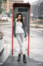 Fashion woman talking in the retro phone booth Royalty Free Stock Photo