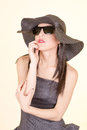 Fashion woman wearing sunglasses and hat portrait of summer serious girl studio shot Stock Photography