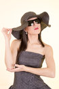Fashion woman wearing sunglasses and hat romantic portrait of summer happy girl studio shot Stock Photos