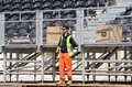 stock image of  Fashion worker on the construction of spectator seats in Baku