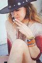 Fashion young boho style woman enjoy smoking a cigarette Royalty Free Stock Photo
