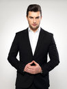 Fashion young businessman in black suit Stock Images