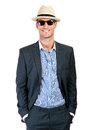 Fashion young man holding his fashionable sunglasses over white background Royalty Free Stock Images