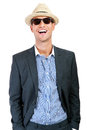 Fashion young man holding his fashionable sunglasses over white background Stock Photo