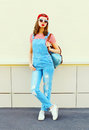 Fashion young pretty woman wearing a denim jumpsuit in the city over white Royalty Free Stock Photo