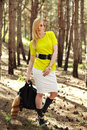 Fashion young woman in a pine forest portrait girl outdoors of Stock Photo