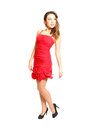 Fashion young woman in a red dress isolated on white background Royalty Free Stock Images
